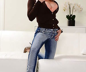 Hot mommy type babe poses fully clothed in denim jeans before undressing
