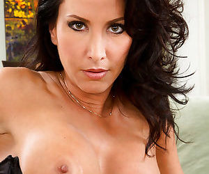 Beauty brunette Lezley Zen shows off her nice hard nipples and tits