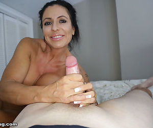 Mature mom Mrs Simone jacks off a big cock in the nude while masturbating