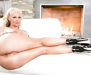 Buxom blonde Phoenix Marie in high heels fondling huge juggs