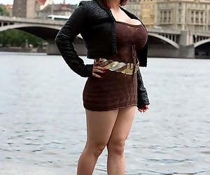 Thick Asian MILF Tigerr Benson uncorks her massive fake tits