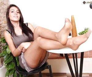 Pantyhose adorned babe Petra flashing upskirt views and bare feet