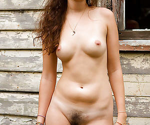 Petite amateur Marla strips naked outdoors to pleasure hairy vagina