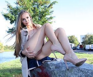 Leggy young girl Angel B is totally into public exhibition
