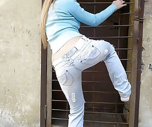 Sweet teenage amateur demonstrates her goods in the public place