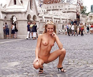 Kinky amateur blonde with gorgeous fanny posing naked in public places