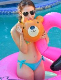 Young hottie in swimming pool heads indoors for fun with her huge dildo