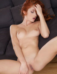 Pale redhead Michelle H slips off bra and underwear set for nude posing
