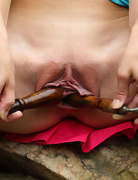 Solo girl Kymberly Brix pleases her horny pussy in garden with hose and tools