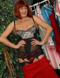 Aged redhead lady Miss Abigail shows off her upskirt underwear in nylons