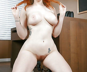 Busty girl with red hair Lauren Phillips spreading hairy vagina in office