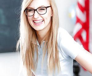 Young blonde nerd in glasses Alexa Grace posing in schoolgirl uniform