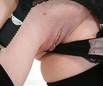 Elegant mom Betsy Blue strips off to masturbate her snatch and to get orgasm