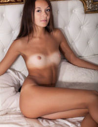 Petite Euro Veselin flaunts her tanned body and completely bald beaver