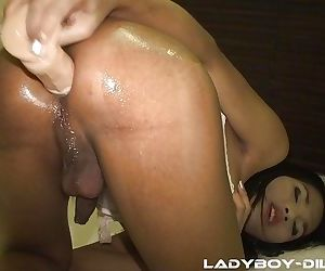 Nasty oiled up Asian shemale Pam sticking a big dildo deep up her asshole