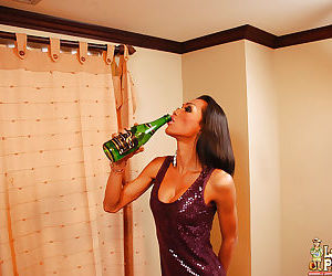 Kinky Asian tranny Fon inserting bottle into anus while masturbating