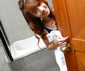 Skinny redheaded Asian ladyboy Nutty baring tiny tits and hung cock in bath