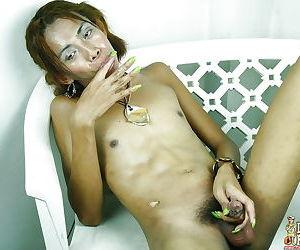 Skinny Asian tranny Lhara baring tiny tits while spreading for masturbation