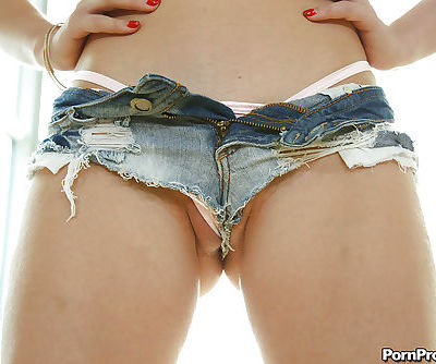Beautiful blonde female Staci Carr freeing amazing ass from denim shorts
