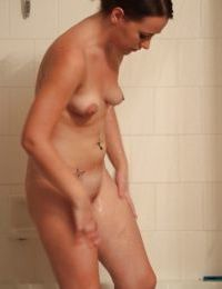 Alisa Ford is undressing in her bath and playing with boobies