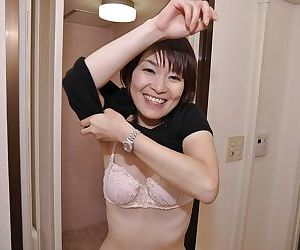 Sassy asian MILF with tiny tits Miki Ando undressing and taking shower