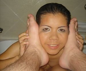 Petite Thai girl Fone takes a shower before sucking on mans toes