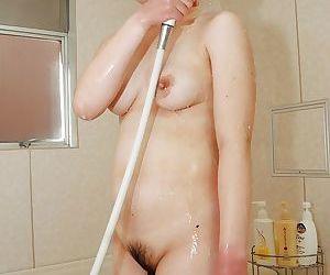 Asian MILF Aki Tanihara alluring shower and repartee her hairy intrude