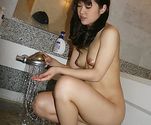Fetching asian cutie with tempting fanny and prudish bust leave taking shower