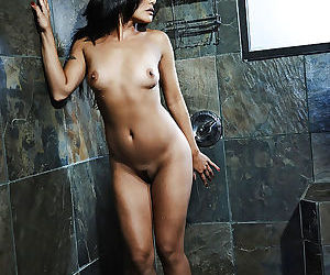 Stunning asian MILF performs a steamy strip scene in the shower