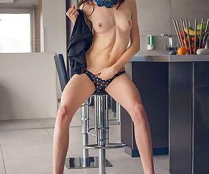 Leggy solo girl Adel Morel undresses for masturbation of bald vagina