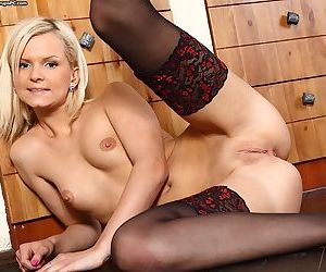 Slippy blonde with nylon clad legs getting nude and teasing her slit