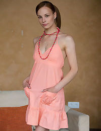Skinny teen girl Mia casts her peach colored dress aside to model naked