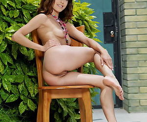 Tiny Euro teen babe Divina A flaunts her skinny young body outdoors