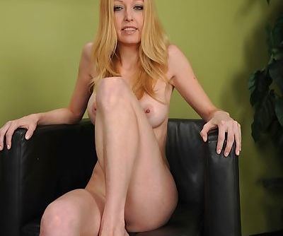 Skinny blonde babe Elle Kenelle revealing tight MILF ass while stripping