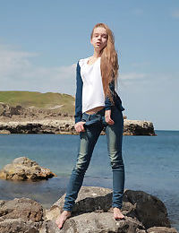Skinny girl Milena D sheds jeans on beach to show bald twat underwater