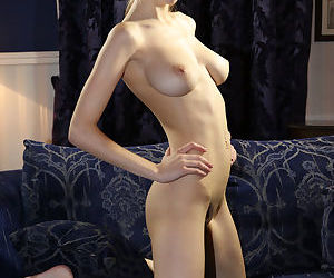 Skinny young girl Milla takes off frilly lingerie to pose naked on sofa
