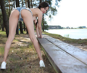 Skinny young girl Li Moon sheds her country girl attire on bench in the woods