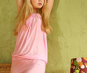 Sweet young Sylvia spreads naked draped in in her pink sexy dress