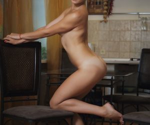 Damp redhead Kika serves up her damp nude body in the dining room