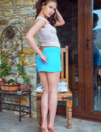 Young teen girl Hilary C undresses on a chair for nude modeling debut