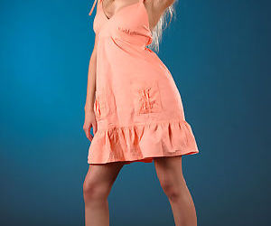 Young solo girl Barbara D models naked after removing peach colored dress