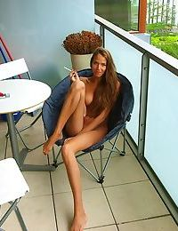 Adorable amateur Silvie Deluxe smoking and posing nude outdoor