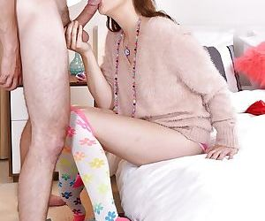 Flexible young slut Kasey Warner giving oral sex in pink underwear and socks