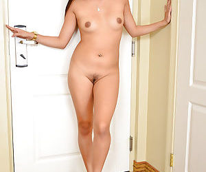 Tanned Asian beauty Angelina Chung is playing with her tiny tits