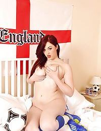 Natural redhead teen Jaye showing off ripe breasts and twat in football cleats