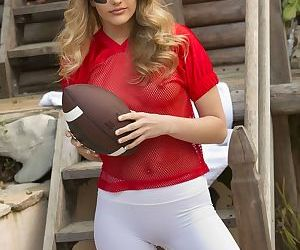 Teen football player Kenna James doffs see thru top and spandex bicycle shorts