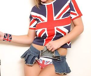 Young and busty teen Demi D slips off UK themed clothing to pose naked
