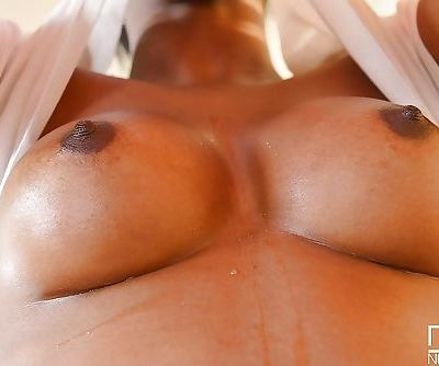Black MILF Jasmine Webb takes time out from workout to pose nude