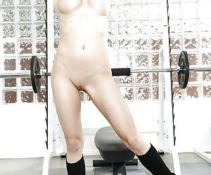 Young blonde chick Jeanie Marie Sullivan getting naked in weight room