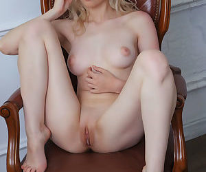 Young blonde model Innes A removes her sexy bra to finish getting naked